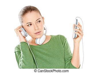 Woman listening to a new music download on her headphones...