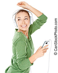 Happy woman dancing to her music which she is listening to...