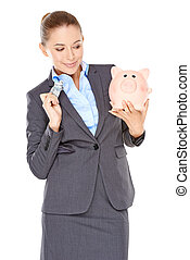 Woman deciding whether to spend or save holding a dollar...