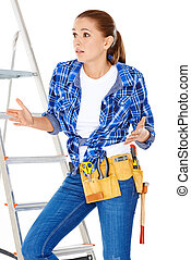 DIY handy woman at her wits end raising her palms in the air...