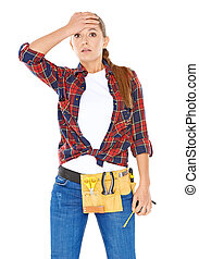 DIY handy woman with a dazed expression standing with her...