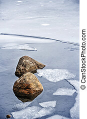 Icy shore in winter - Broken ice floating on water at cold...
