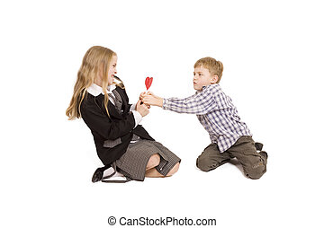 Boy and girl fighting over a lolipop - Boy and girl fighting...