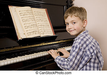 Little boy playing the piano