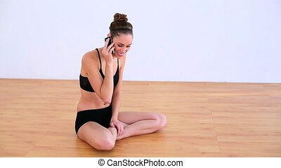 Smiling woman making a phone call - Smiling brunette in...