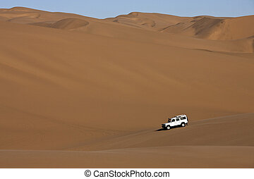 Sand dunes in Namibia - Four wheel drive vehicle in the sand...