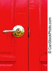 Red wooden door - the door handles.