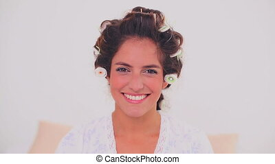 Concentrated woman in hair curlers - Concentrated brunette...