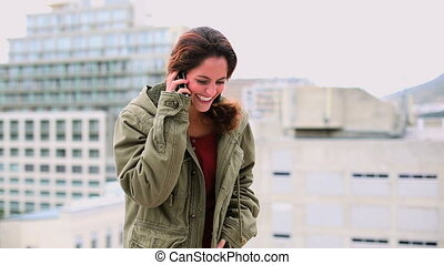 Pleased brunette woman making a photo