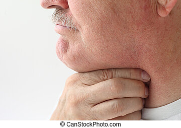 older man with throat pain - mature man with a very sore...