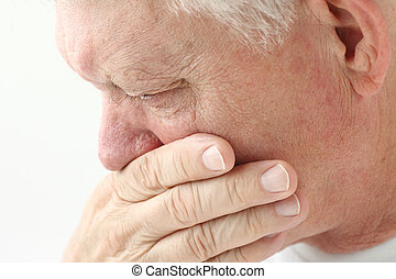 man with nausea close up - nauseated mature man holds hand...
