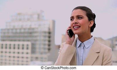 Thoughtful beautiful businesswoman