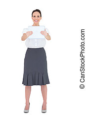 Cheerful businesswoman holding her tablet pc