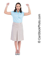 Victorious stylish businesswoman posing on white background