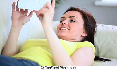 Attractive woman lying on couch