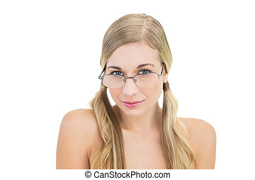 Serious young blonde woman looking over her glasses