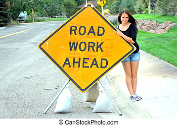 Road work sign. - Road work ahead sign displayed outdoors.