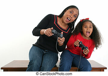 Mother and Daughter Video Games - African American mother...