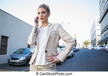 Serious elegant businesswoman on the phone