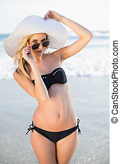Gorgeous blonde in elegant black bikini posing on a...