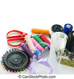 Sewing kit - Close-up image of sewing stuff over white...