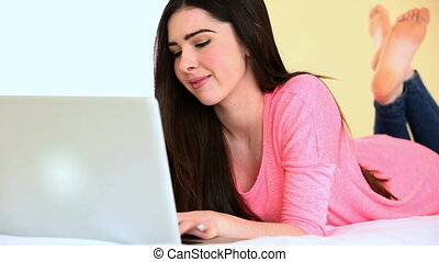 Attractive woman using her laptop - Attractive woman...