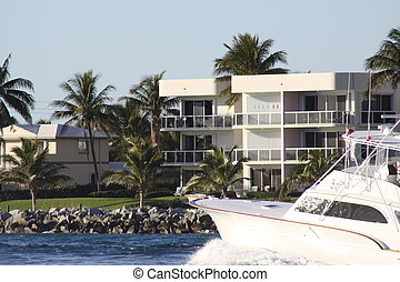 Waterfront Living - A boat passing through an inlet waterway...