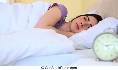 Attractive woman sleeping in bed