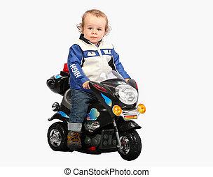 Little child on motorcycle