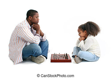 Father Daughter Chess Match - Father and daugther playing...