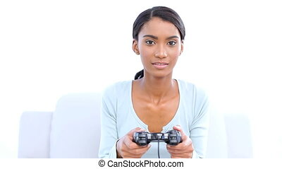 Woman playing and winning at video games on white background