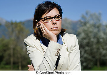 Worried woman with her hand rest on her face