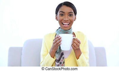 Cheerful woman drinking a coffee on white background