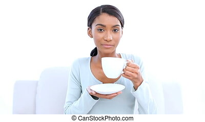 Pretty woman drinking a coffee on white background