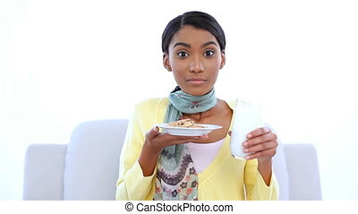Cheerful woman smelling cookies