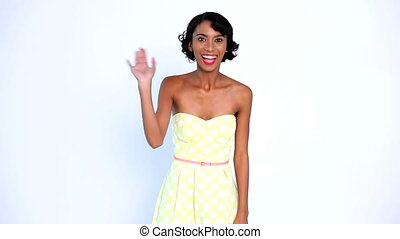 Woman waving and blowing a kiss on white background