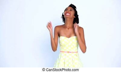 Excited woman gesturing and raising arms on white background