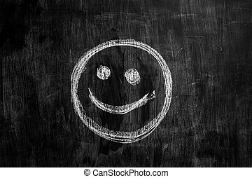 Smiley face drawn on blackboard