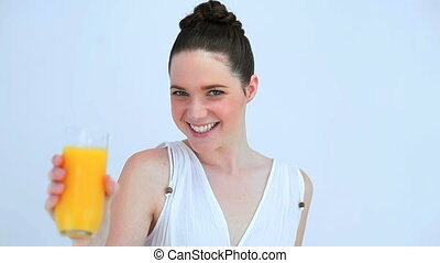 Beautiful woman holding a glass of juice - Beautiful woman...