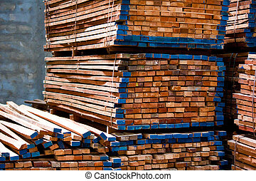 Lumber pile in wood store at construction site
