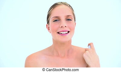 Woman holding an asthma inhaler on white background