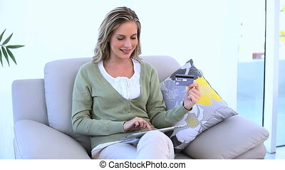 Cheerful woman holding her credit c
