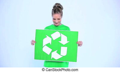 Blond woman holding a banner for the environment on white...