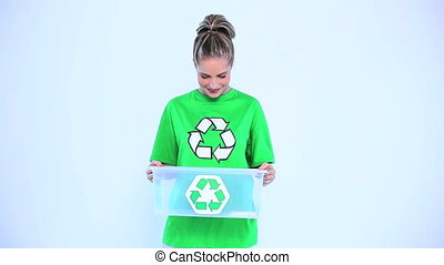 Blond woman holding a recycling bo