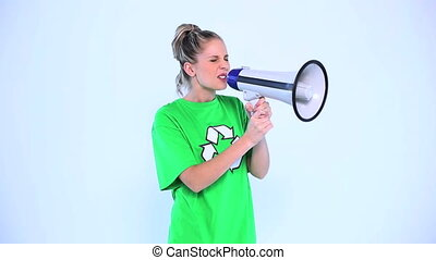 Attractive environmental activist screaming in a megaphone...
