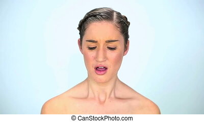 Young woman has asthma on white background