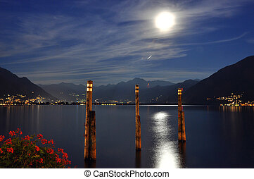 Moon light over a lake with mountains - Moon light over an...
