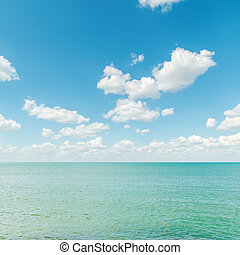azure sea with blue cloudy sky