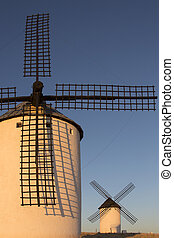Windmills - La Mancha - Spain - Late afternoon sunlight on...