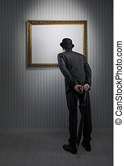 Art gallery - Retro elegant man standing and observing a...